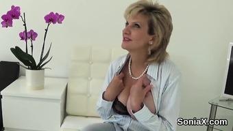 Disloyal english language milf lady sonia yields her big boobs
