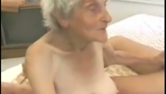 Really old light colored ladies with zero tits fidgeting with a cock