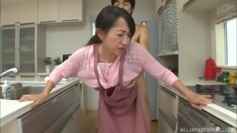 Sizzling kitchen sex session along with lovely Japanese people babe Takita Eriko