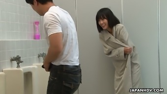 Crazy Oriental girl Uta Kohaku pisses on penis of a complete stranger dude in a masses bathroom