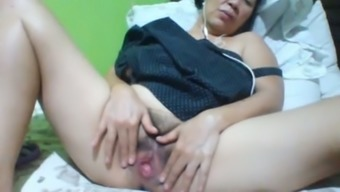 Filipina slippery with dim body hair and saggy substantial boobs masturbates herself