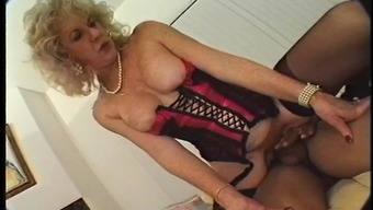 Big breasted granny in intimate apparel spreads her both legs for getting a substantial surpassing incline