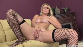 Busty toddler in fishnet stockings consists of a small crimson searching for pleasure