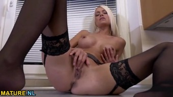 Do the job clothes striptease using an incredibly heated blond