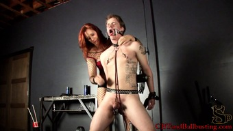 Inked young pony gets dealt with by the red-haired dominatrix