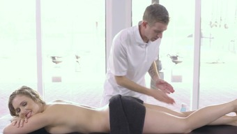 A blonde is snagged open toward the massage therapy desk as she s getting played
