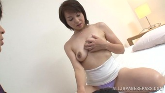 Japanese people mother two fingers her pussy and generates a warm blowjob to the man