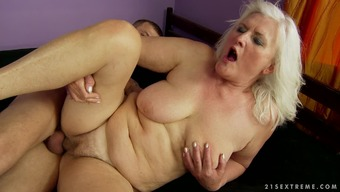 Unique and busty Judi is satisfying her younger fucker