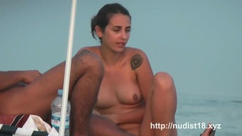 Uncovered shore voyeur spies on any perky breasted nudist