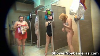 Monitoring camcorder receives chubby senior mommys open in a bathe