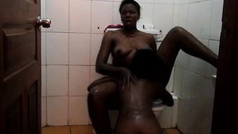 West african lesbos wayward newbie pussy play in the toilet