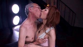 Japanese moaner Tsubasa Amami gives a blowjob to some lewd old adult man