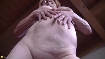 Eatable senior granny seductively exhibiting her organic tits