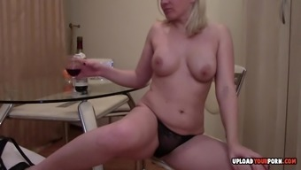 Grow older wife gets attractive and begins fidgeting with mauve bottle