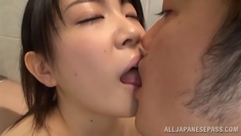Delicate Far eastern bimbo having fun her big bubbly tits being caressed gently in the shower