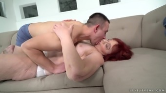 Brunette granny Marsha enjoys getting fucked by a generous younger guy
