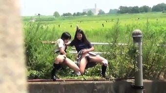Twisted oriental hookers urinating