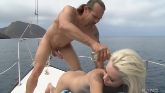 Petite skinny blonde Elsa Jean deepthroats a long cock on a yacht