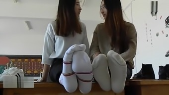 Double Chinese girl feet tickling