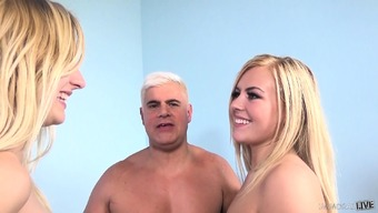 Gorgeous blondes Summertime Moment and Alexa Kindness spend playtime with a dangled stud