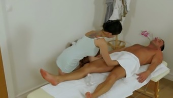 Bosomy Thai hottie gives head light colored big prick in massage therapy parlor