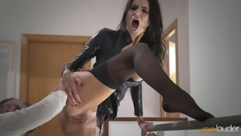 Delightful raven haired MILF in sexy leather-based coat of paint gets fucked on stairs challenging