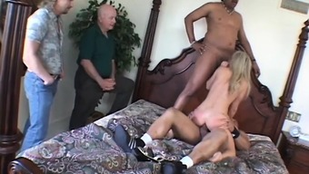 Attractive black companion with the use of big hooters gains two vast cardinal dicks
