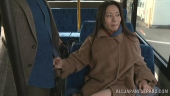 Complex cougar dressed greatly giving a man charming handjob within the bus but fire