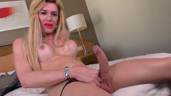 Panties clothed blonde shemale cums through out herself after milking her dong
